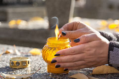 Lighting a candle Royalty Free Stock Images