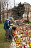 Lighting candles. Children lighten candles at Monument of Katyn Victims. Begin of week of mourning in Poznan, Poland Royalty Free Stock Photography