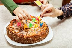 Lighting candles on a birthday cake Royalty Free Stock Photography