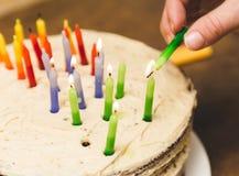 Lighting Candles on a Birthday Cake Stock Photos