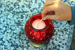 Lighting a candles Royalty Free Stock Images