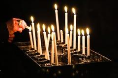 Lighting prayer candles Stock Photo