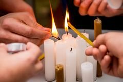 Lighting candles during events in honor of dead soldiers, prese. Rving memory of the fallen heroes royalty free stock photography