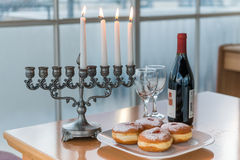 Lighting of candles for Hanukkah holiday. Stock Images