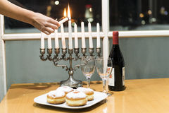 Lighting of candles for Hanukkah holiday. Stock Photo
