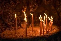 Lighting candles on rocks Royalty Free Stock Photo