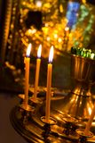 Lighting candles in russian orthodox church. Religion Royalty Free Stock Photography