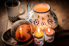 Lighting of candles in various forms. Stock Photo