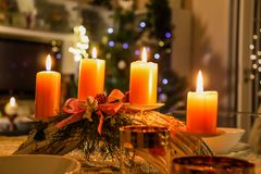 Lighting candlestick, candle, advent, christmas tree outside. Lighting candlestick, candle on table, advent, fire, christmas, tree holly royalty free stock image
