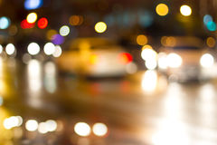 Lighting cars on defocused in the street at night for background Royalty Free Stock Photo