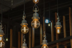 Lighting on the chandelier in the lamplight, light bulbs hanging Stock Photos