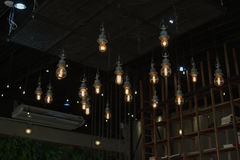 Lighting on the chandelier in the lamplight, light bulbs hanging Stock Image