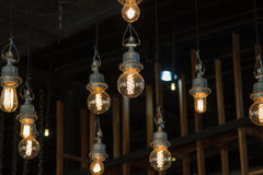 Lighting on the chandelier in the lamplight, light bulbs hanging Royalty Free Stock Images