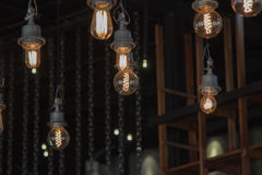 Lighting on the chandelier in the lamplight, light bulbs hanging Royalty Free Stock Photo