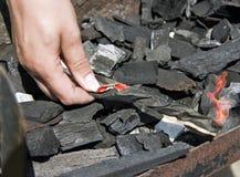 Lighting charcoal Stock Photo