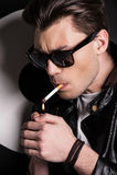Lighting a cigarette. Stock Photo