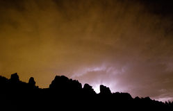 Lighting and Clouds Behind the Devils Backbone Royalty Free Stock Photo