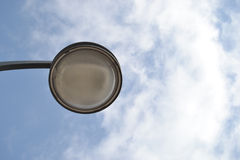 Lighting and clouds. Spherical lamp before the cloudy sky Stock Images