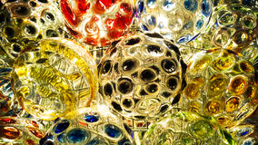 Lighting on color paint of glass ball Stock Photography