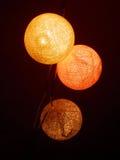Lighting cotton balls Royalty Free Stock Images