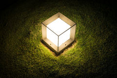 Lighting cube lantern on grass at night. Stock Photography