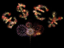 Lighting currency. Pound sterling, dollar, euro and japanese yen symbols formed by fireworks on black background Royalty Free Stock Photos