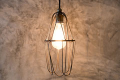 Lighting decor on cement wall. Light bulb vintage Royalty Free Stock Image