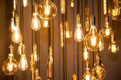 Lighting decor. Old vintage fashion light bulbs. Bottom view Stock Photos