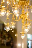 Lighting decor. Retro light bulb filament close up. Retro Christmas light bulbs. Chandelier lamp on the ceiling in Dining room Adjusting the image in a Luxury royalty free stock photo