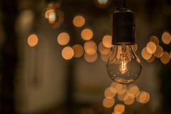 Lighting decor. Retro light bulb filament close up.Illuminated. Stock Photo