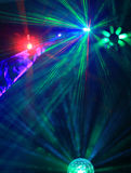 Lighting disco with bright beams of searchlight, laser show. Royalty Free Stock Photo