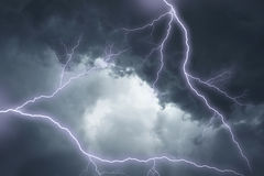 The lightning in dramatic stormy sky Stock Image