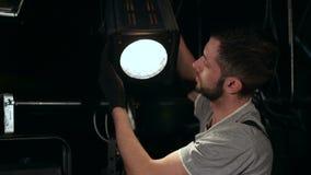 Lighting engineer adjusts the lights on the stage. stock video footage & Lighting Engineer Repairs The Light Device. Stock Video - Video ... azcodes.com