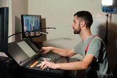 A lighting engineer works with lights technicians control on the concert show. Professional light mixer, mixing console. Equipment for concerts royalty free stock photos