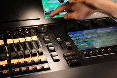 A lighting engineer works with lights technicians control on the concert show. Professional light mixer, mixing console stock images