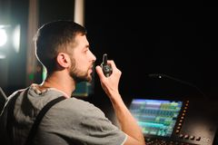 A lighting engineer works with lights technicians control on the concert show. Professional light mixer, mixing console. Equipment for concerts stock photos