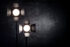 Lighting equipment on a black background old shabby wall Stock Images
