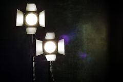 Lighting equipment on a black background old shabby wall Stock Photos