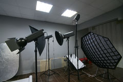 Lighting equipment in the interior studio. Photographic lighting equipment in the interior studio royalty free stock photos