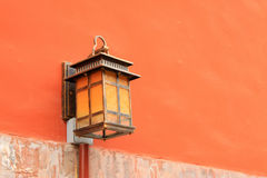 Lighting equipment in the red wall in the Zhengjue temple in Old Royalty Free Stock Images