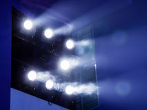 Lighting equipment on the stage. The spotlight through the smoke. Theater performance.  Royalty Free Stock Photos