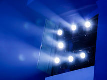 Lighting equipment on the stage. The spotlight through the smoke. Theater performance.  Stock Photos