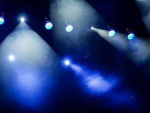 Lighting equipment on the stage. The spotlight through the smoke. Theater performance.  Royalty Free Stock Photo