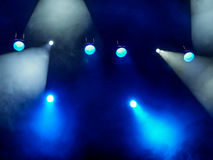 Lighting equipment on the stage. The spotlight through the smoke. Theater performance.  Royalty Free Stock Images