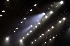 Lighting equipment on the stage of a theatre or concert hall. The rays of light from spotlights. Halogen and led light bulbs. Lens lighting Royalty Free Stock Photo