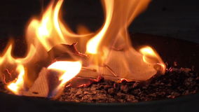 Lighting a fire stock video footage