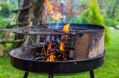 Lighting fire during spring barbecue garden Stock Photography