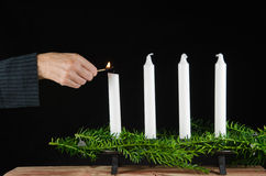 Lighting the first advent candle Stock Images