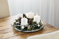 Advent Wreath with four candles on wooden table. White curtains background. stock photos