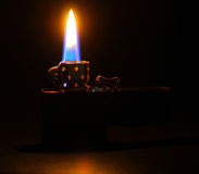 Lighting flame on dark background Stock Photography